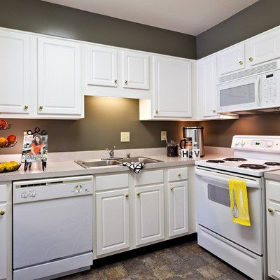 Fully equipped kitchen with maple or white cabinetry